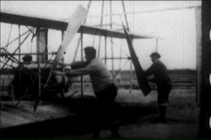 Footage of the first successful airplane flight by the Wright Brother in 1903, Kittyhawk, North Carolina, in an American broadcast about the history of aviation (1900s)