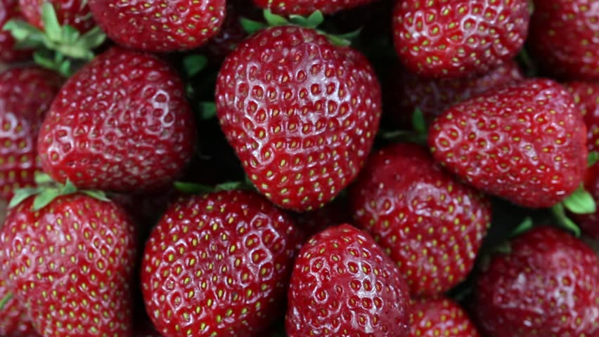 Fresh, ripe, juicy strawberries rotate. Red strawberries clockwise rotation . Close up