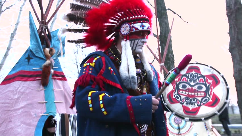 North American Indian in traditional dress, close-up