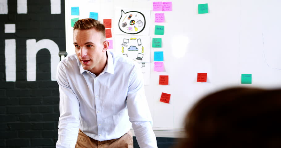 Businessman interacting with coworkers in office 4k   Shutterstock HD Video #18523379