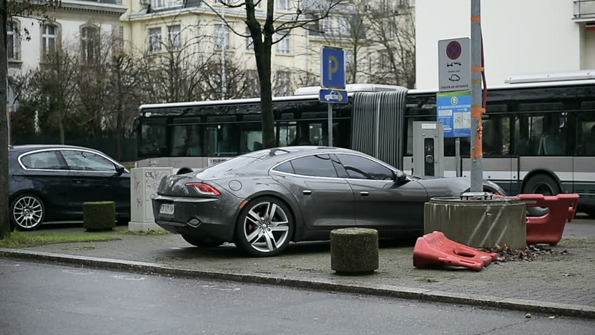 paris france circa 2016 side view of fast fisker karma electric car charging at electric. Black Bedroom Furniture Sets. Home Design Ideas