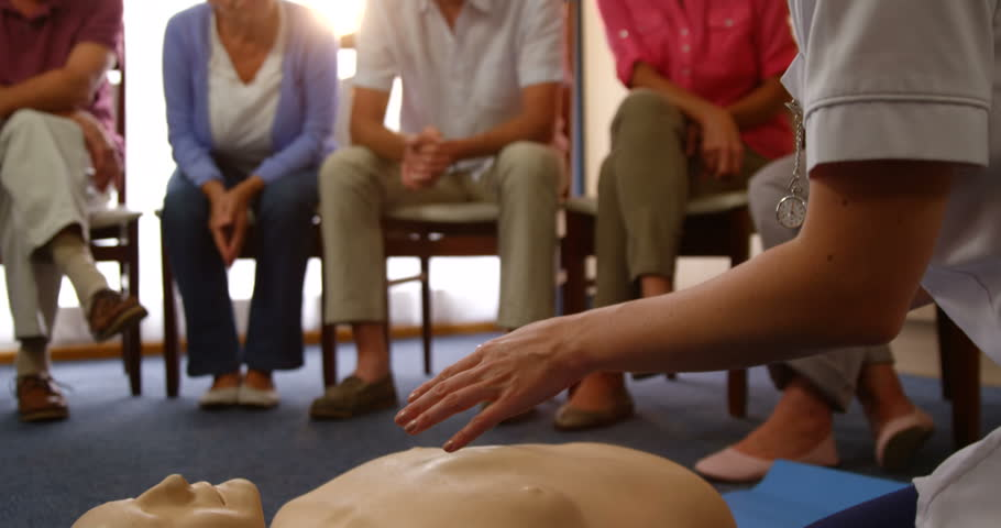 Senior people watching resuscitation training being performed on a dummy by doctor 4K | Shutterstock HD Video #18549095