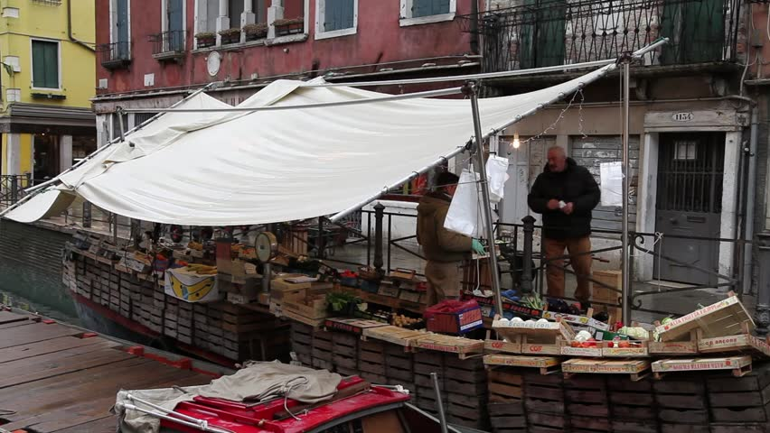VENICE - JANUARY 4: Fruit selling on a boat in a canal, January 4, 2012 in Venice.