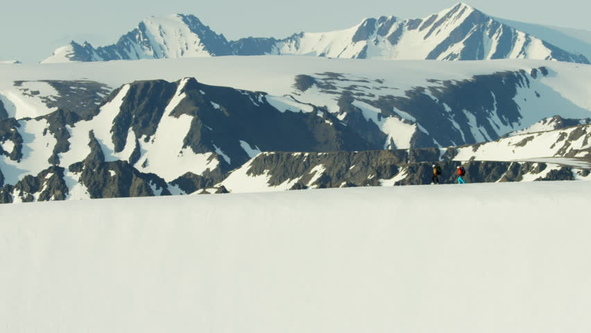 Aerial view of mountaineers on a snow covered mountain in Alaska America | Shutterstock HD Video #18611855