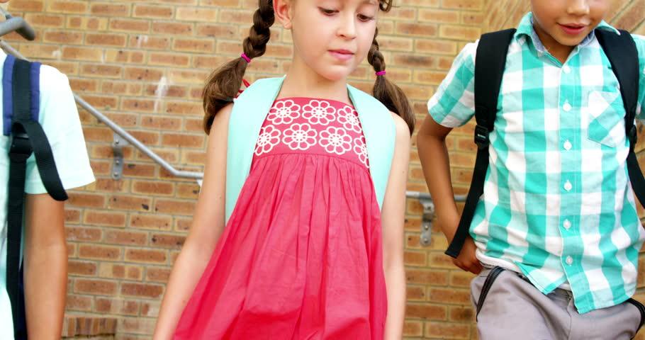 Slow motion of schoolkids walking on staircase at school 4k | Shutterstock HD Video #18615545