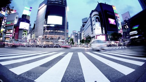 Shibuya Crossing in Tokyo, Japan Tracking upwards from ground with fish-eye lens