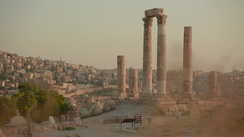 An establishing shot of Amman, Jordan with Roman ruins foreground. (Amman, Jordan 2010s)