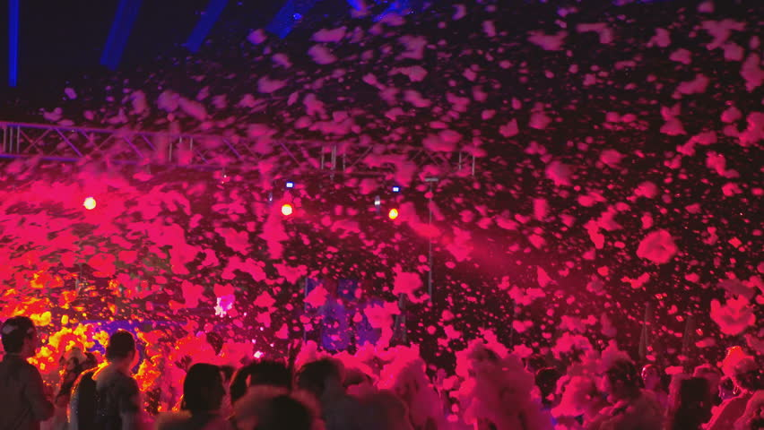 ALANYA, TURKEY - JULY 11, 2016: Many young resting on the foam party night. | Shutterstock HD Video #18675635
