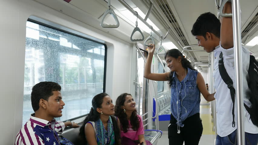 4k footage of college going boys and girls doing various activities inside metro train and on station. | Shutterstock HD Video #18699698