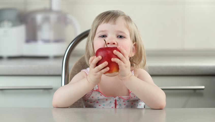 Baby eating apple | Shutterstock HD Video #1872835