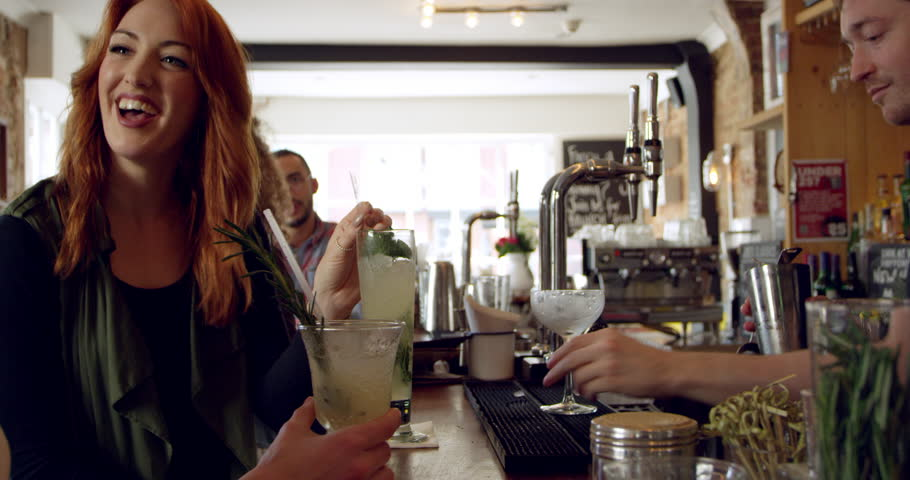 Busy Bar With Bartender Mixing Cocktails Shot On R3D