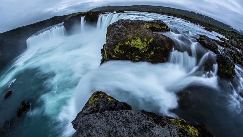 Godafoss powerful scenic waterfall dreamlike time lapse slow motion fish eye 4k