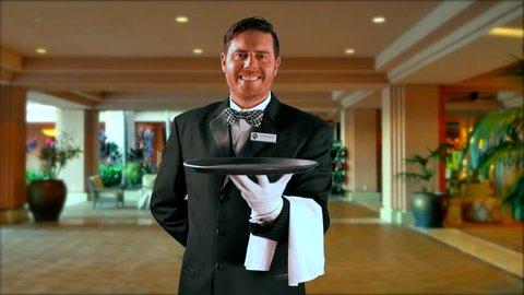 4K Maitre'D Restaurant Fine Dining Hospitality in Black Formal Tuxedo Smiling