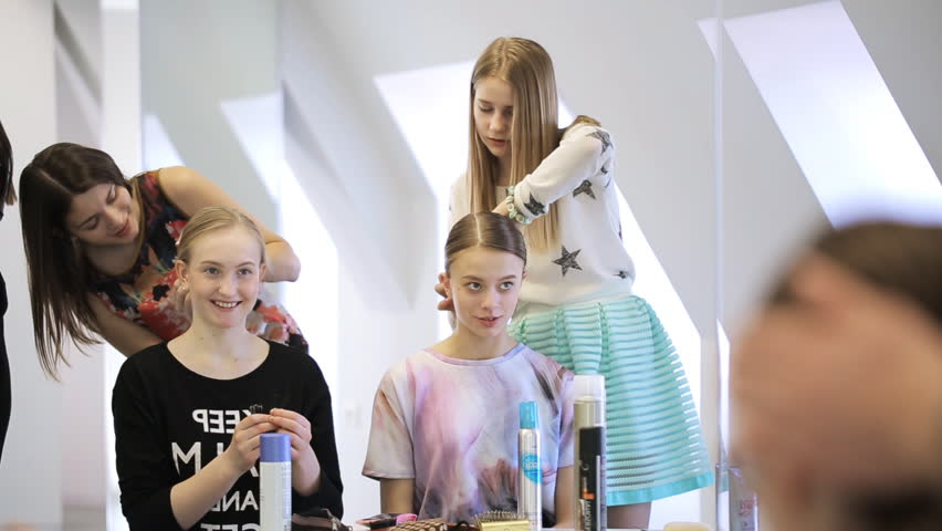 Stylists create hairstyle for pretty girls in white studio   Shutterstock HD Video #18768935