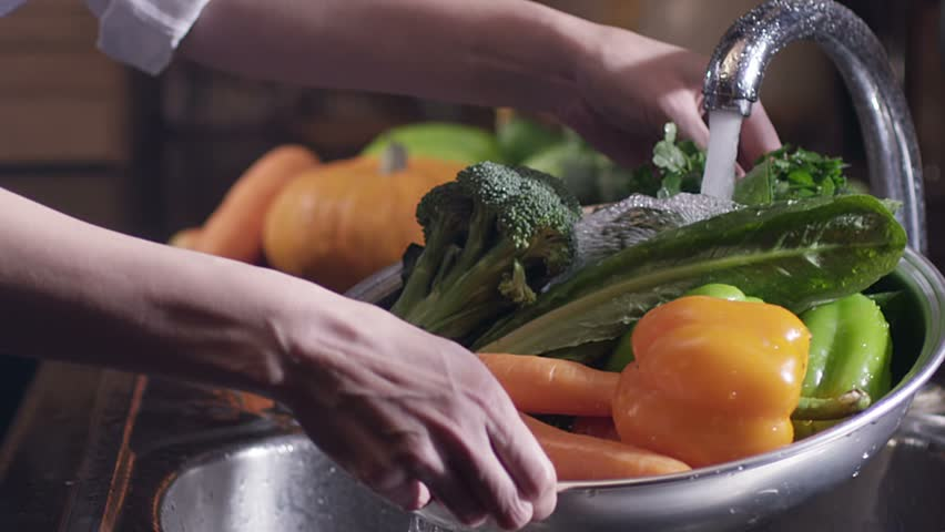 Scene of washing fresh vegetables. broccoli, pepper and carrots.  Under the tap. Shot on RED EPIC Cinema Camera in slow motion