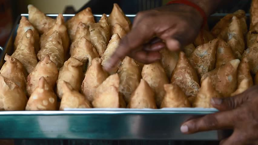 CHENNAI,INDIA - CIRCA August 2016 :Hand counting samosas in a tray
