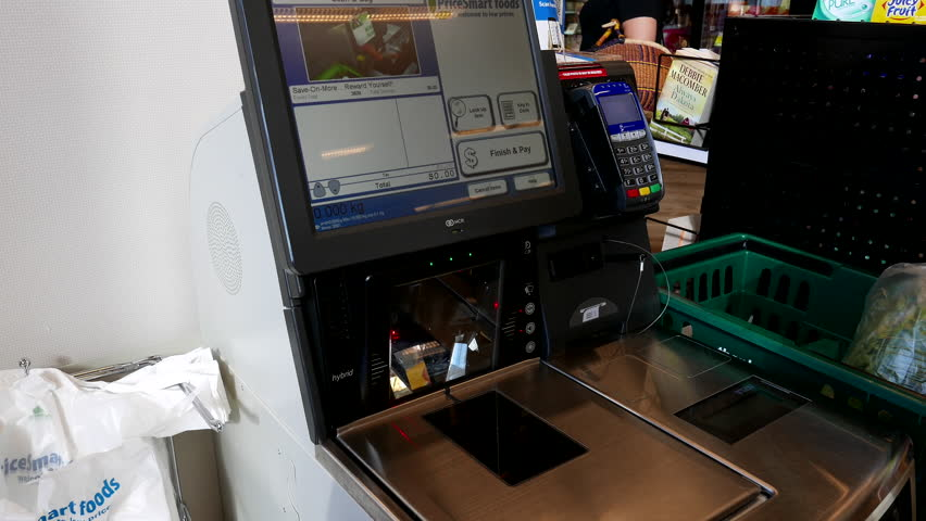 Burnaby, BC, Canada - August 10, 2016 : Close up of woman paying foods at self-check out counter inside Save on foods store   Shutterstock HD Video #18900008