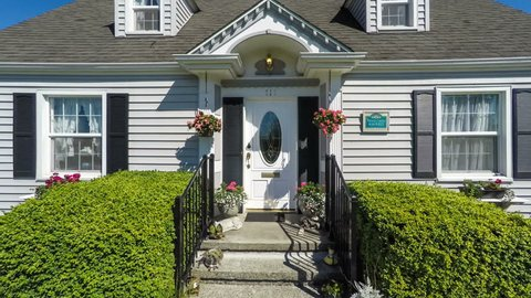 Quaint American suburban home; departure dolly shot