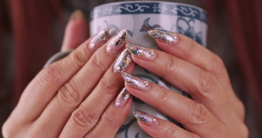 Nail art manicure making nice manicured woman palms stock woman holding a cup of tea 4k stock footage clip prinsesfo Image collections