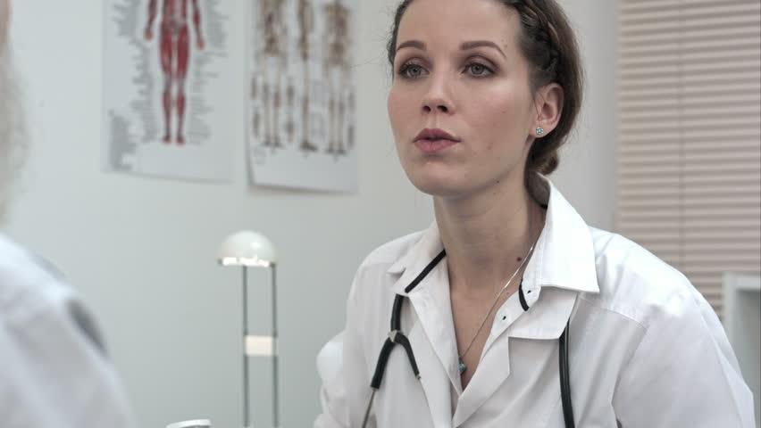 Beautiful female doctor holding bottle of pills. | Shutterstock HD Video #18925187