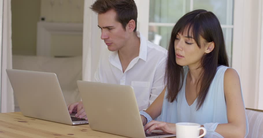 Man and woman working on laptop computers together | Shutterstock HD Video #18953336