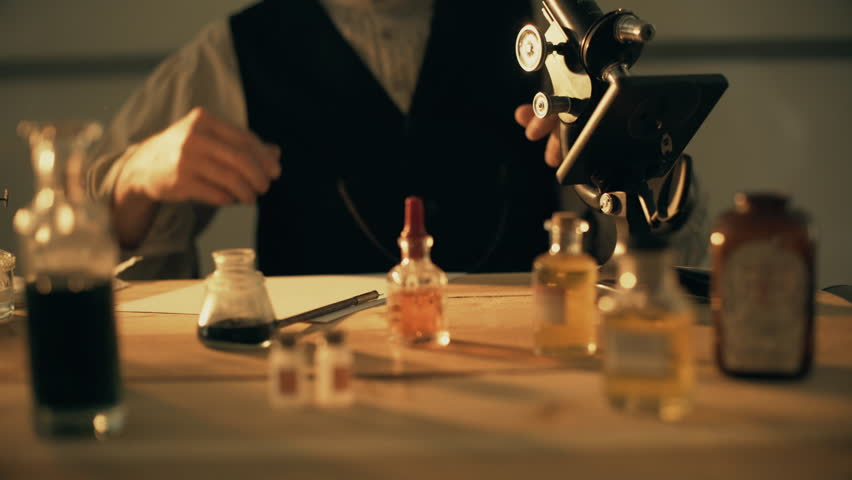 turn of the century scientist using a microscope 4k