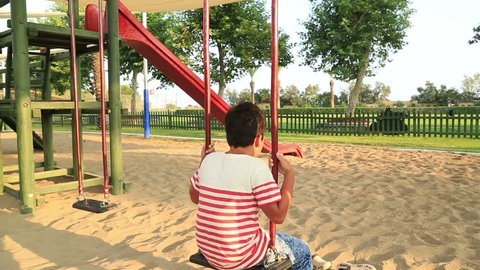 Lonely, sad boy at the playground