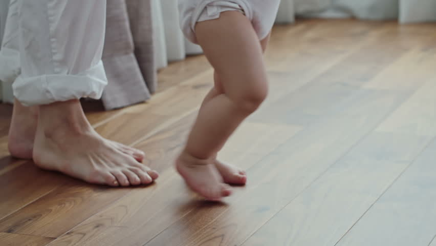Side View Of Barefoot Legs Woman Walking Behind Little Baby Hd Stock Clip