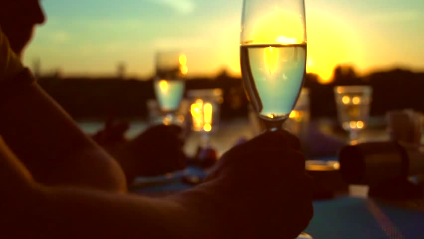 Group of people toasting and drinking champagne on the restaurant terrace over sunset. Celebrating. Glasses with Sparkling Champagne over nature Background. Resort. Slow motion full hd 1080p | Shutterstock HD Video #18985423