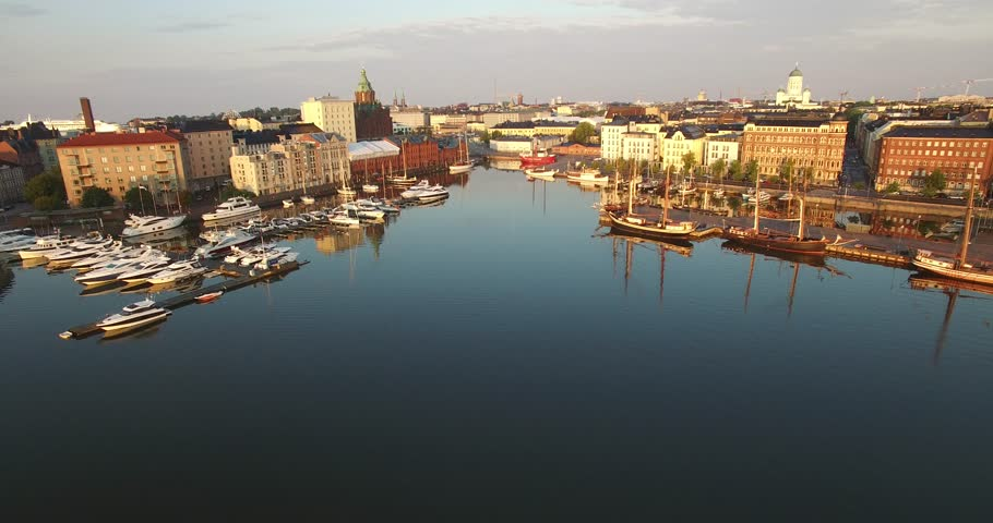 Aerial view and drone footage of Helsinki bay area, old city skyline, boats and yachts in Helsinki, the capital of Finland