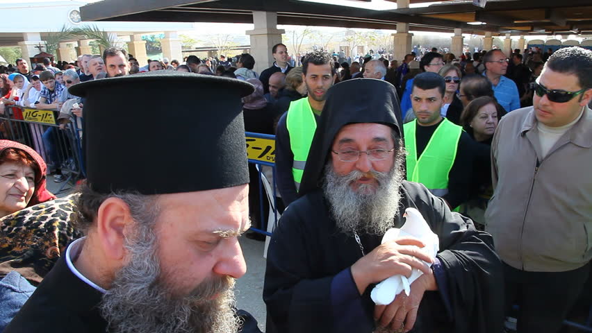 QASR AL YAHUD, ISRAEL - JANUARY 18: Greek Orthodox    Priest holds the white pigeon during the Epiphany at Qasr Al Yahud, Israel on January 18, 2012.