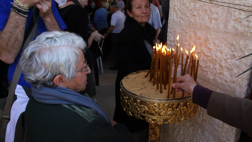 QASR AL YAHUD, ISRAEL - JANUARY 18: Pilgrim light candles during the Epiphany at Qasr Al Yahud, Israel on January 18, 2012.