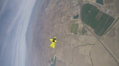 Lifestream men jumping with a wingsuit parachute, slow motion