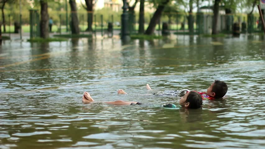 Kids Swimming In A Lake two kids swimming in water in the lake, happy day stock footage