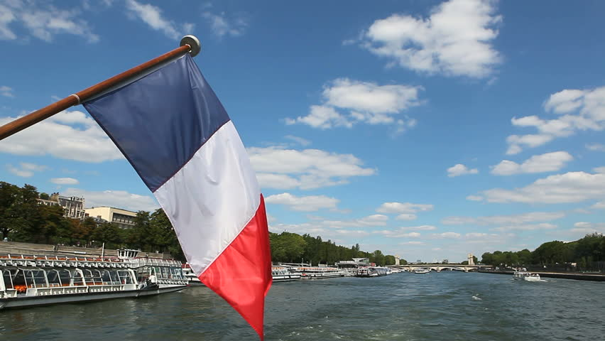 floating down the river on moving boat with french flag 1080x1920 HD video