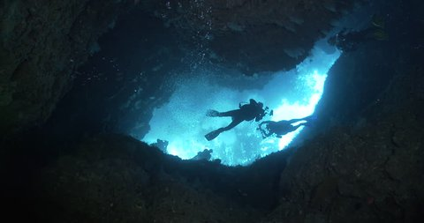 Group of scuba divers diving in cavern in Solomon Islands, 4K UltraHD, UP35588