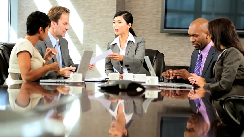 Female asian chinese business executive heading a meeting checking contracts with her multi ethnic team | Shutterstock HD Video #1924885