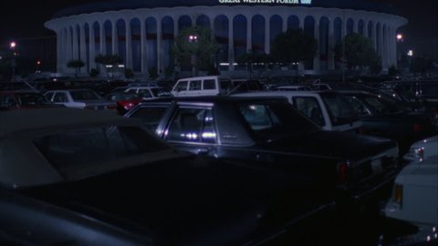 night tilt up across full parking lot Great Western Forum LA forum, indoor arena House Lakers basketball team from 1967 1999 , concert venue font color red Needs additional clearance font