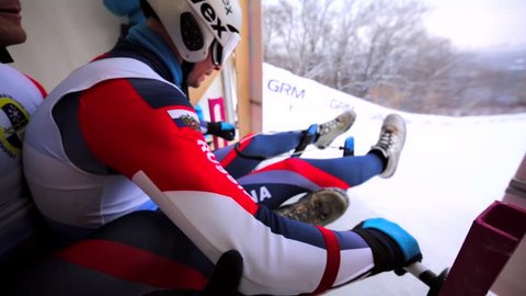 MOSCOW, RUSSIA - JANUARY 23, 2016: Close view of a sportsman's elbow and hand. Russian tobogganers's start. Luge World cup at Sparrow Hills (Vorobyovy Gory)