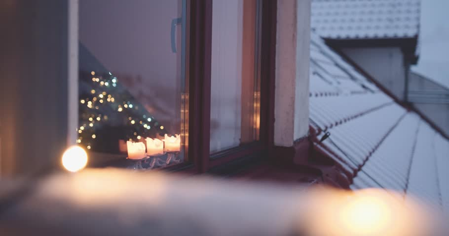christmas window view burning candles and twinkling festive lights 4k dci slow motion 120