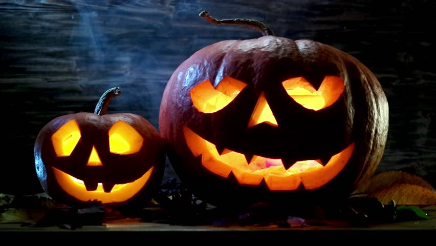 halloween pumpkins mysteriously illuminated from within hd stock video clip - Halloween Background Video