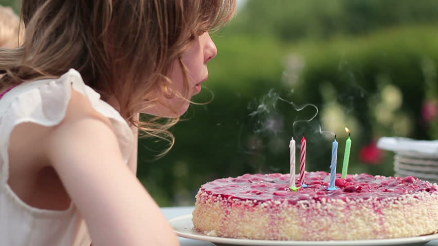 Birthday cake with man hand burning candles slow motion stock little girl sitting at the table and blowing the candles while having birthday party slow sciox Image collections