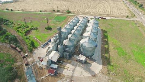 Steel grain wheat silos elevators storage. Agriculture industry 4k aerial video. Bread production, harvest grain trade concept.