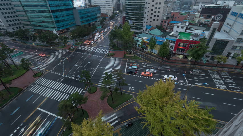 Timelapse high angle shot of transport traffic on junction in capital city Seoul, South Korea. Road marked with zebra crossings | Shutterstock HD Video #19393045