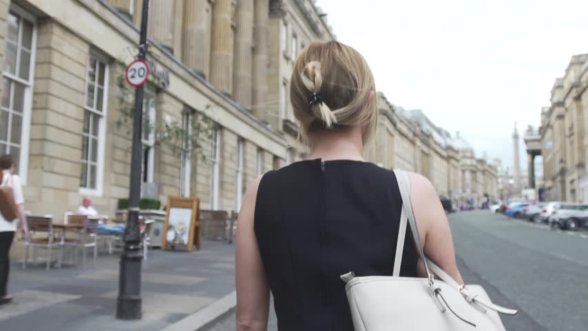 Sexy Attractive good looking young blonde woman in black dress walks alone in London | Shutterstock HD Video #19399606
