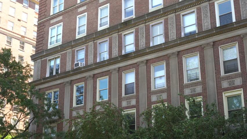 Brick Apartment Building dx establishing shot of an urban brick apartment building in city