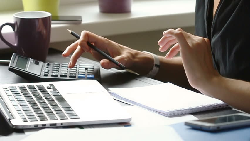 Close up of female accountant or banker making calculations. Home finances, investment, economy, saving money or insurance concept. Hands closeup. | Shutterstock HD Video #19478605