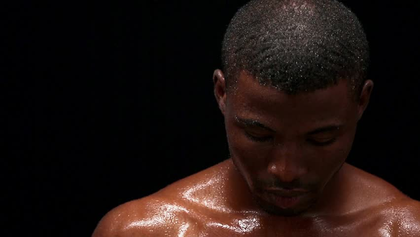 1fba0d0fc015 Wet naked Afro-American young man posing for photographer. Young man sweaty  after hard gym training. Short haired man with muscular body isolated on  black ...
