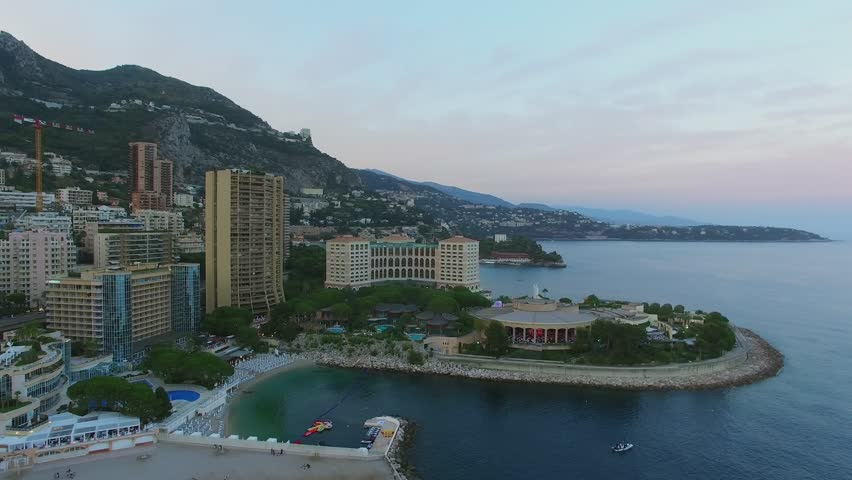 MONTE CARLO, MONACO - AUG 02, 2016: Townscape with Larvotto beach near Meridian Beach Plaza hotel, Le Bahia, Les Villas Du Sporting and Sporting Monte-Carlo at summer evening. Aerial view