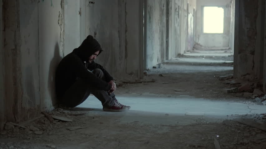 Hooded young man inside destroyed abandoned building,back against wall,slow motion, dramatic.Young man with social issues, inside a big demoloshed building in 100fps.Camera gimbal or crane motion. | Shutterstock HD Video #19538305